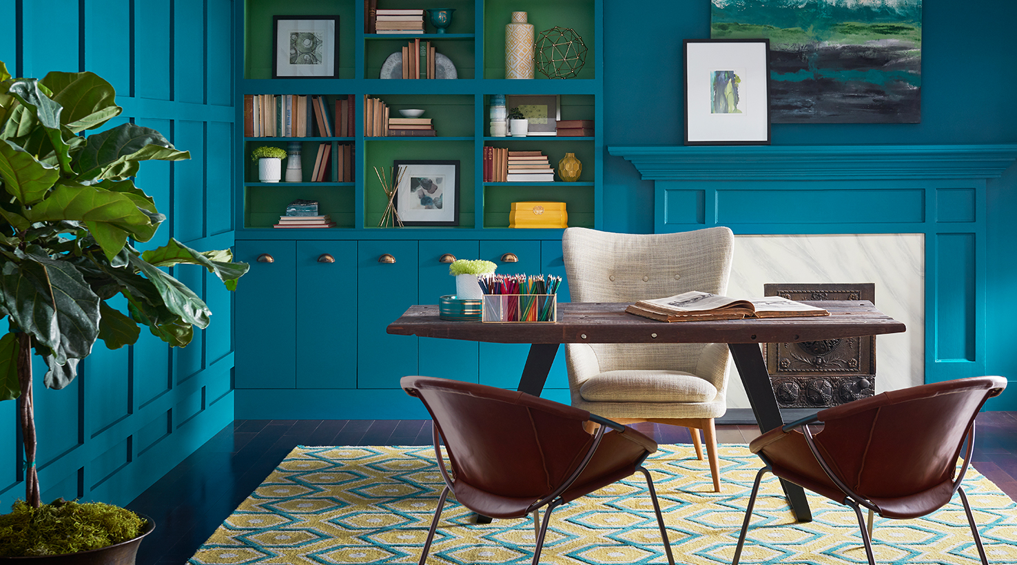 Elegant study with vibrant blue wall and cabinet color
