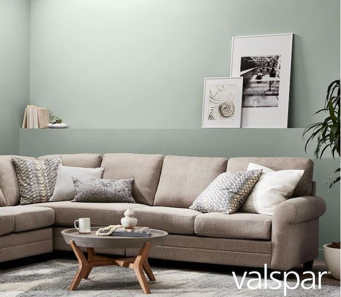 Sectional couch in living room painted Garden Flower color by Valspar