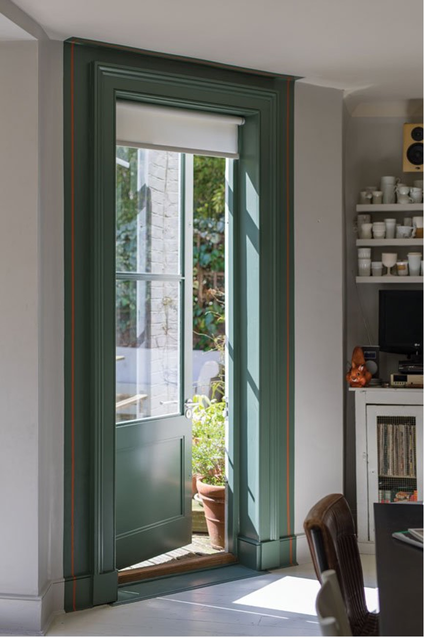 Doorway with accent trim painted in Green Smoke by Farrow & Ball